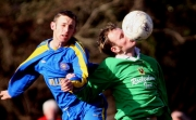 Close Control by Gavin O'Connor of Passage, under pressure from Ian Kenny. AOH Cup, Passage 1 Carrigtwohill 0, Rockenham, 25.02.06, Billy Lyons.