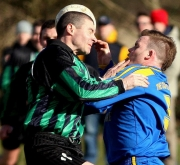 Carrig's Niall Kidney (right) and ex Cork City ace Fergus O'Donoghue in close combat during last weekend's St Michael's Cup semi-final that Mayfield won 1-0. Both sides are in action tomorrow (Sat), Carrig at home to Los Zarcos in the County Cup, Mayfield away to Ballyvolane in 1B. Picture taken at Slatty Park, 04.03.06, Billy Lyons