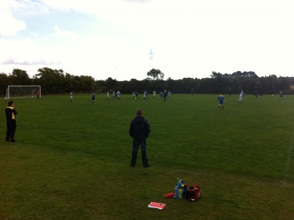 Managers John O'Sullivan and Jason Waters watch carefully as the action unfolds